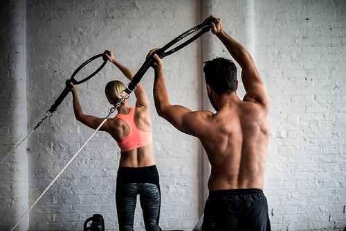 Reformer Pilates Photography - Couple Arm Exercise